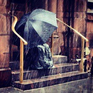 Man With Umbrella on Church Steps