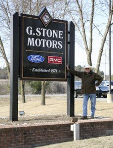 Gardner Stone of Family Trade by his G-Stone Motors sign (Source: GSN)
