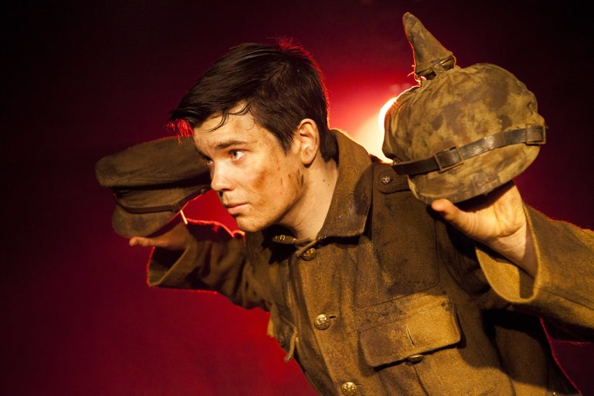 Alex Gwyther in OUR FRIENDS THE ENEMY. Photo by  Pamela Raith.