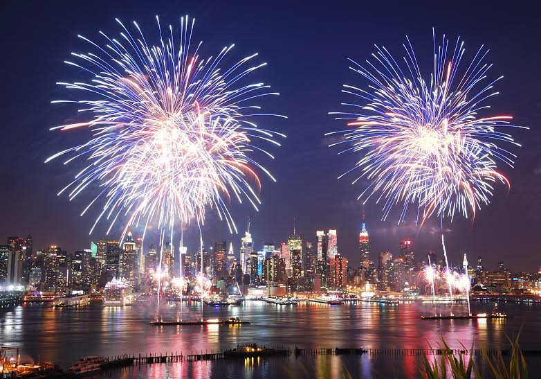 New York City Manhattan July 4th Independence day fireworks show with skyline over Hudson River viewed from New Jersey